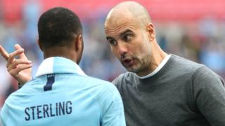 Manchester City boss Pep Guardiola with Raheem Sterling after the FA Cup win over Watford