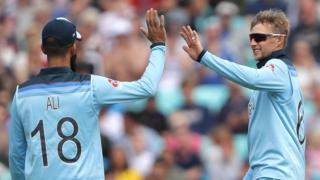 Moeen Ali congratulates Joe Root on his third wicket
