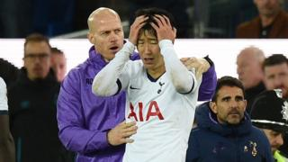 Son holds his head after Gomes injury