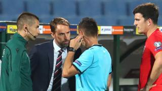 Gareth Southgate speaks to referee
