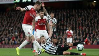 Newcastle players appeal as Aaron Ramsey slots home