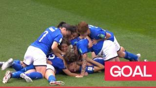 Italy teammates celebrate winning goal.