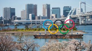 A general picture of the Tokyo skyline with the Olympic rings in the foreground