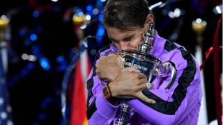 Rafael Nadal hugs the US Open trophy
