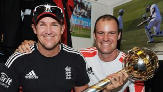 England head coach Andy Flower (left) and captain Andrew Strauss (right) smile holding the mace awarded for becoming the world number one Test side in 2011