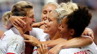 Ellen White (left) celebrates scoring England's first goal