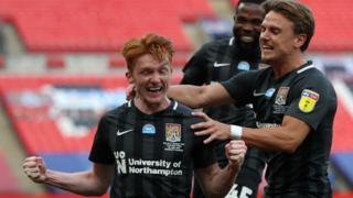Northampton celebrate Callum Morton's goal