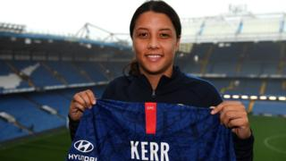 Sam Kerr shows off Chelsea shirt