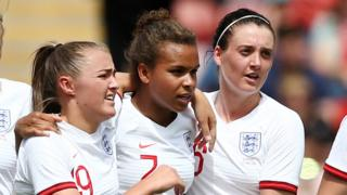 Nikita Parris celebrates the opening goal for England women against Denmark