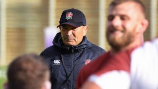 England coach Eddie Jones watches training