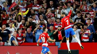 Granada celebrate scoring against Barcelona