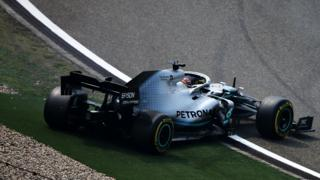 Lewis Hamilton spins off the track in Shanghai