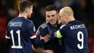Scotland celebrate one of John McGinn's goals