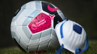 Premier League football and mask