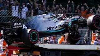 Lewis Hamilton's car is taken away