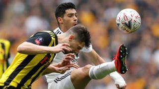 Wolverhampton Wanderers' Raul Jimenez in action with Watford's Craig Cathcart