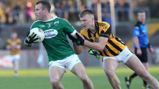 Crossmaglen's Rian O'Neill challenges Gweedore's Neil McGee at Healy Park
