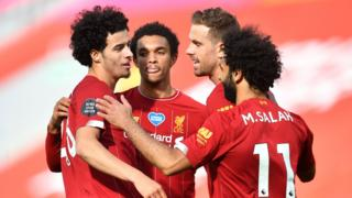 Jones, Salah, Henderson and Alexander-Arnold celebrate