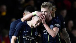 Man City celebrate Phil Foden's goal