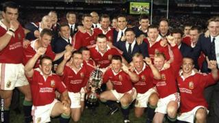 Lions 1997 squad celebrate with the trophy