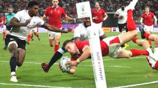 Josh Adams scores for Wales