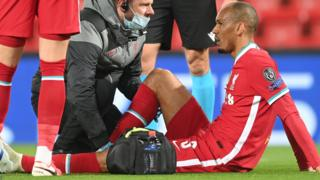 Liverpool's Fabinho lies injured during the Champions League game with Midtjylland