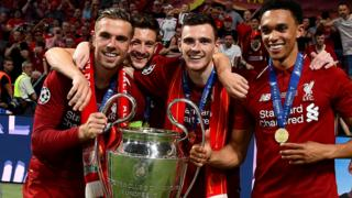 Jordan Henderson and Liverpool players celebrate winning the Champions League in June