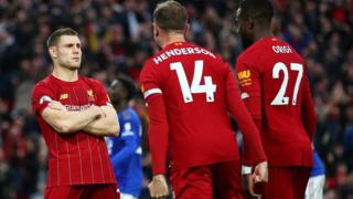 James Milner, Jordan Henderson and Divock Origi celebrate Liverpool's stoppage-time penalty winner against Leicester