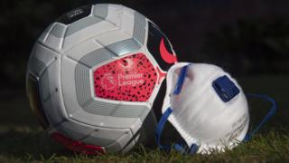 A mask next to a Premier League branded football