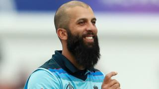 Moeen Ali smiles after taking a wicket against Afghanistan