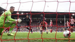 Dean Henderson of Sheffield United spills the ball for Liverpool's winner