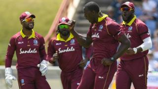 West Indies players Shai Hope, Chris Gayle, Carlos Brathwaite and Ashley Nurse (from left to right) celebrate Brathwaite's dismissal of England's Ben Stokes in the fifth ODI