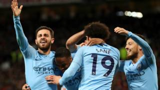 Man City players celebrate