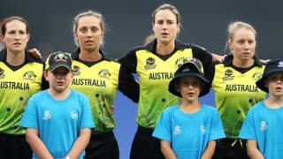Australia's players sing the anthem