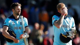 Ben Stokes and Mark Wood walk off dejected