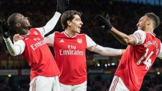 Pierre-Emerick Aubameyang (right) celebrates with Arsenal team-mates