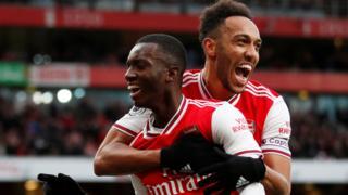 Eddie Nketiah celebrates scoring their first goal with Pierre-Emerick Aubameyang
