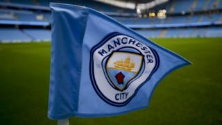 The Manchester City badge on a corner flag at the Etihad Stadium