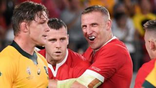 Australia captain Michael Hooper looks dejected as Wales try-scorers Gareth Davies and Hadleigh Parkes celebrate