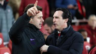 Mauricio Pochettino talks to Unai Emery ahead of their League Cup meeting in December