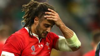 Josh Navidi despairs as he is forced off against France
