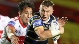 Leeds Rhinos tryscorer Harry Newman takes on Nate Peteru