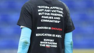 Players wear shirts in support of show racism the red card