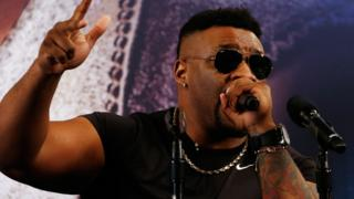 Jarrell Miller speaking into a microphone during a news conference to promote his scheduled fight against Anthony Joshua