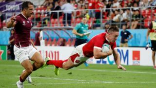 Wing Josh Adams scores Wales' third try