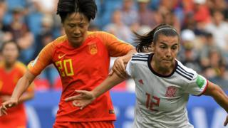Spain midfielder Patricia Guijarro battles China midfielder Rui Zhang
