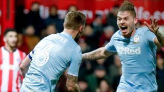 Liam Cooper celebrates his Leeds goal