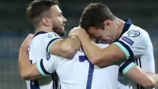 Jonny Evans (right) and Stuart Dallas (left) celebrate with Niall McGinn after he equalised in Thursday's Euro 2020 play-off win over Bosnia-Herzegovina