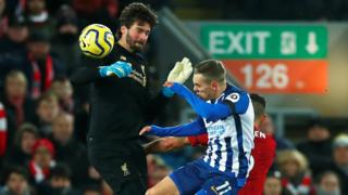 Liverpool keeper Alisson makes the handball outside his area that saw him sent off