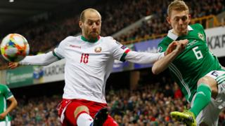 "Northern Ireland""s George Saville in action with Belarus Ivan Maevski"
